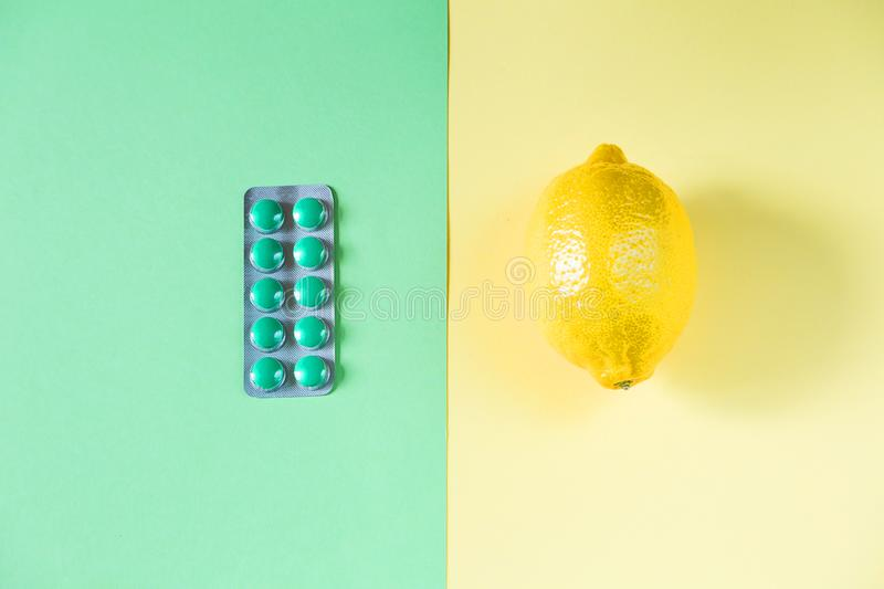 Two opposite medication. Home and science medication. Some medication on two-color paper background. Top view of wo opposite medication. Home and science royalty free stock photography