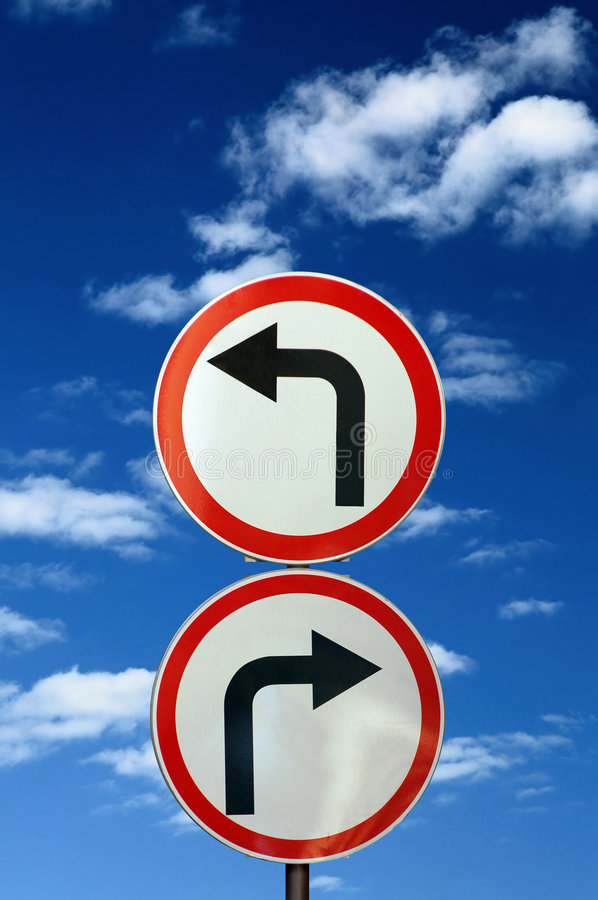 Two opposite road signs against blue sky. And clouds royalty free stock photos