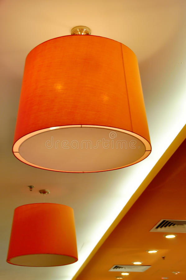 Two Orange Designer Lamps royalty free stock image