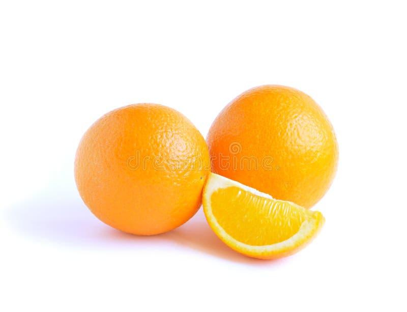 Two orange fruit and lobule. Isolated on white background stock photography