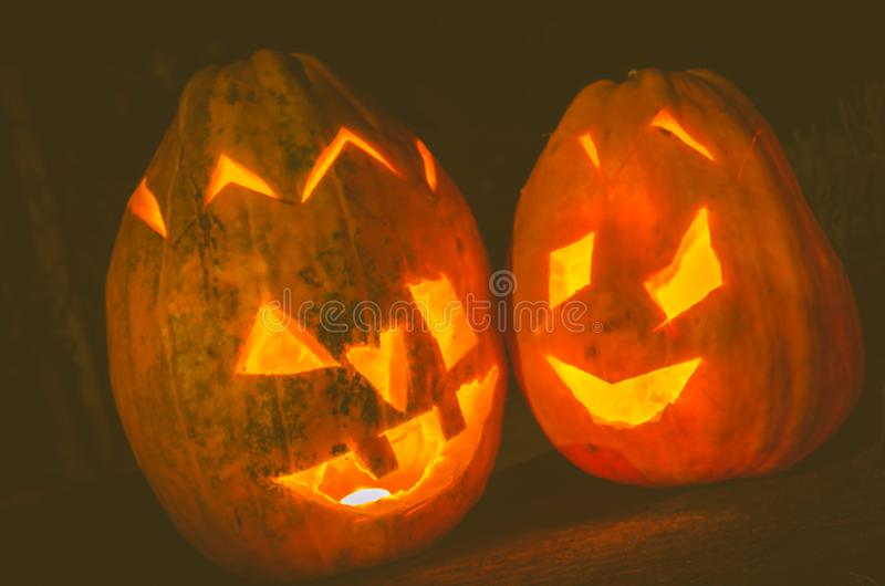 Halloween pumpkin at night. Two orange halloween pumpkins at night royalty free stock photos