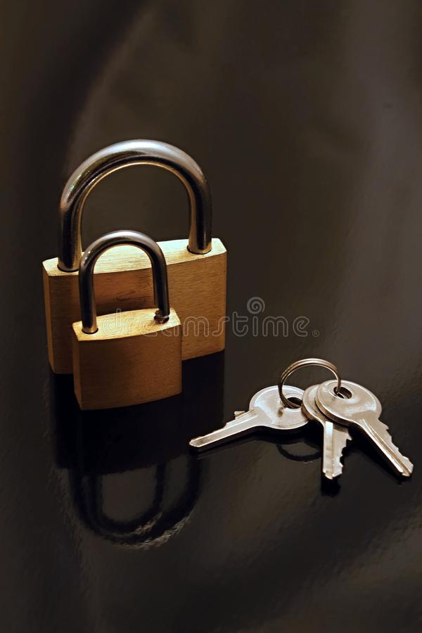 Two padlocks and keys royalty free stock images