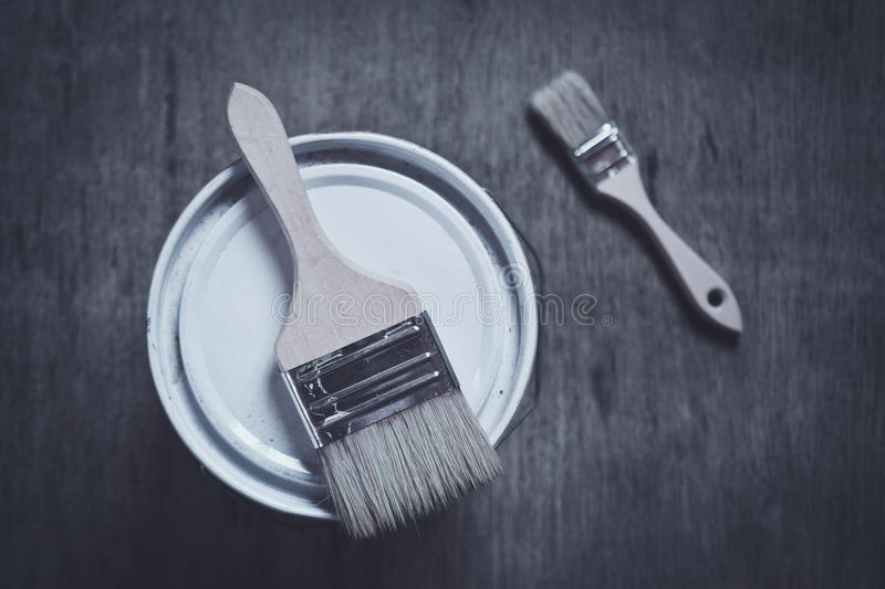 two paint brushes on cans royalty free stock photography
