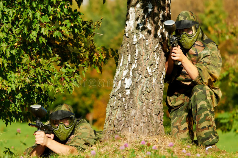 Download Two paintball players stock image. Image of ball, attack - 21628823