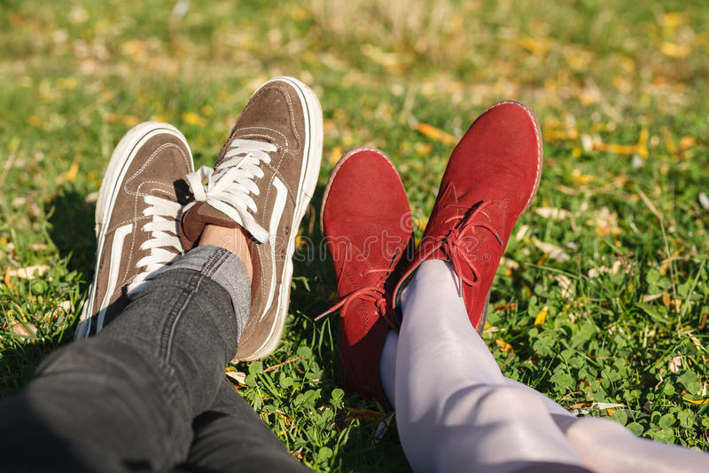 Two pair of legs on grass stock images