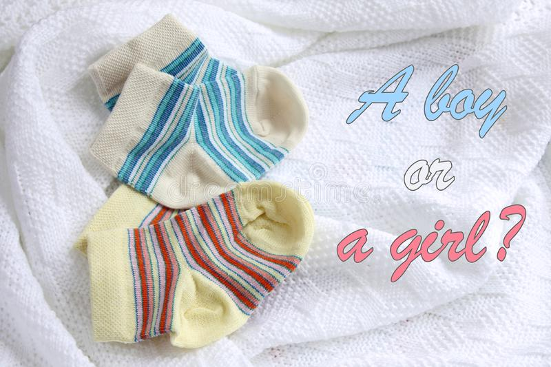 Two pairs of baby socks: blue and yellow striped royalty free stock photography
