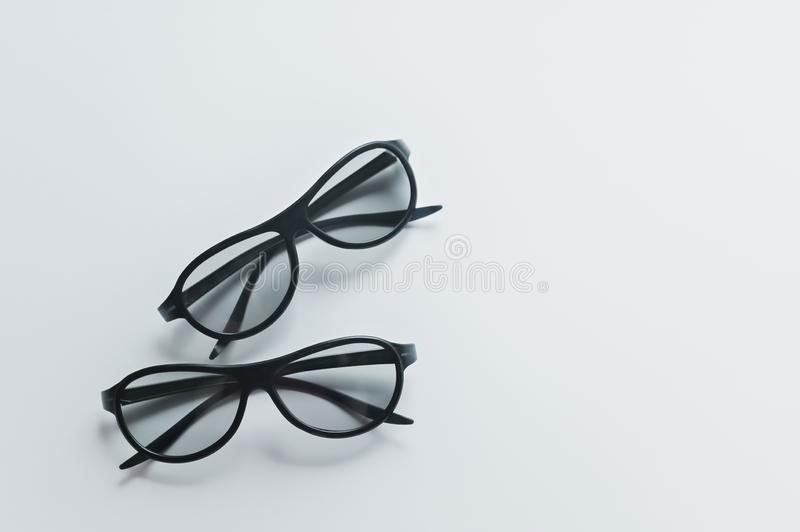 Two pairs of 3d glasses for cinema. Watching movie in 3d. Black glasses stock images