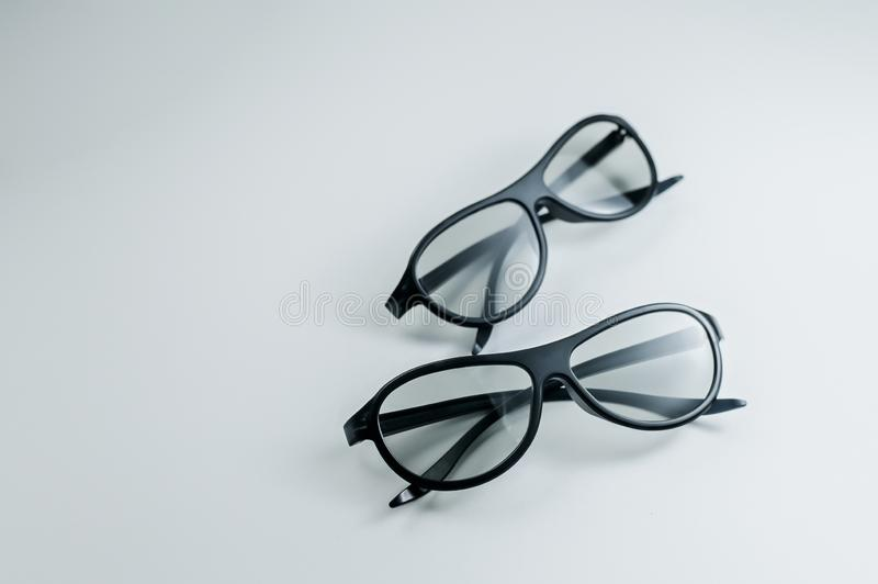 Two pairs of 3d glasses for cinema. Watching movie in 3d. Black glasses. royalty free stock photos