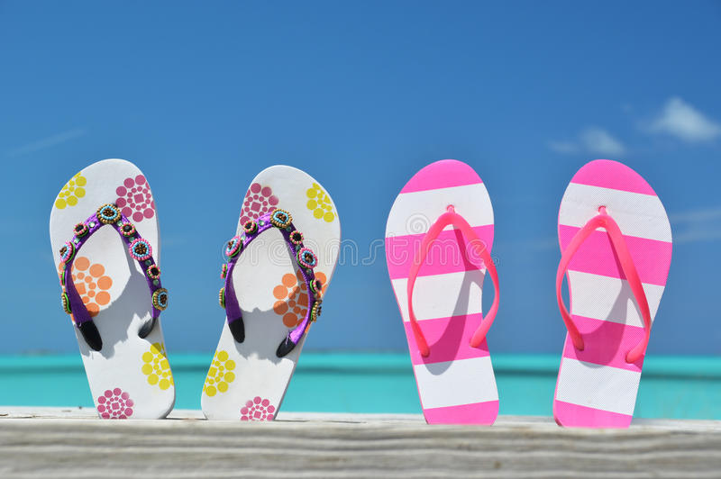 Two pairs of flip-flops stock photo