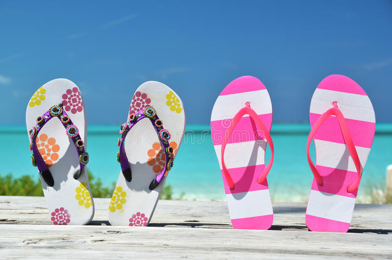 Two pairs of flip-flops royalty free stock image