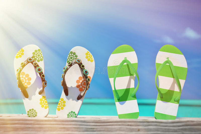 Two pairs of flip-flops stock image
