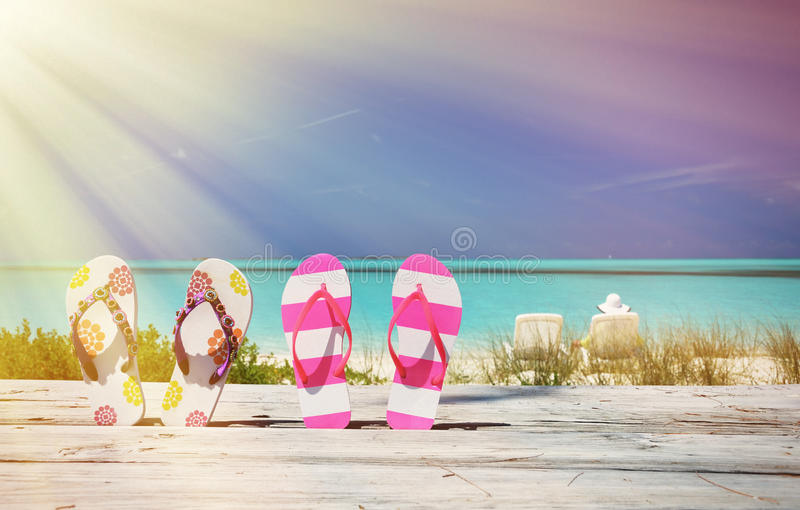 Two pairs of flip-flops royalty free stock photo