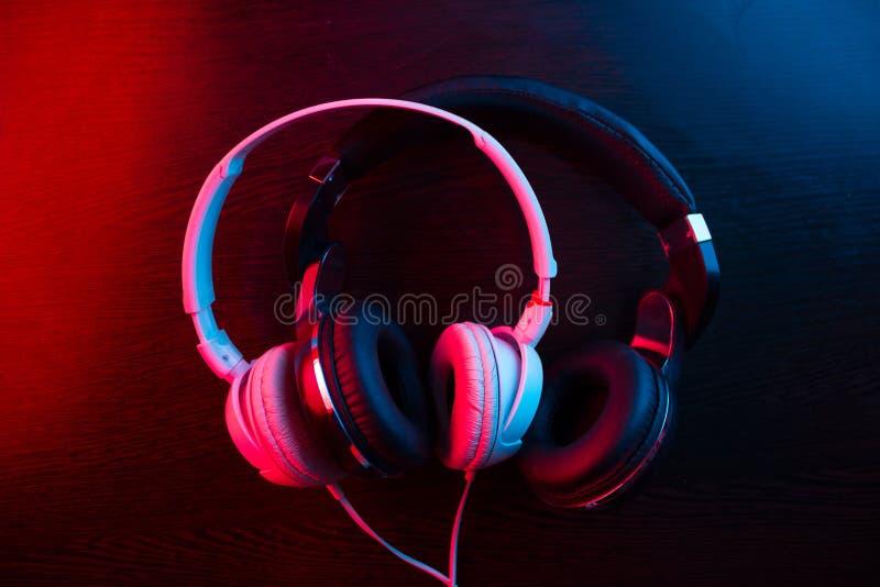 headphones on dark background stock photos