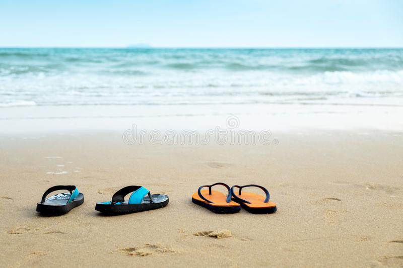Two Pairs of Lover Sandal on the Beach, Romantic Scence in the V. Acation Beach Trip Travel stock photography