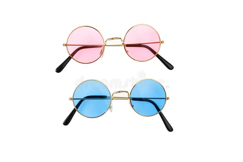 Two pairs of sunglasses, blue and pink stock photo