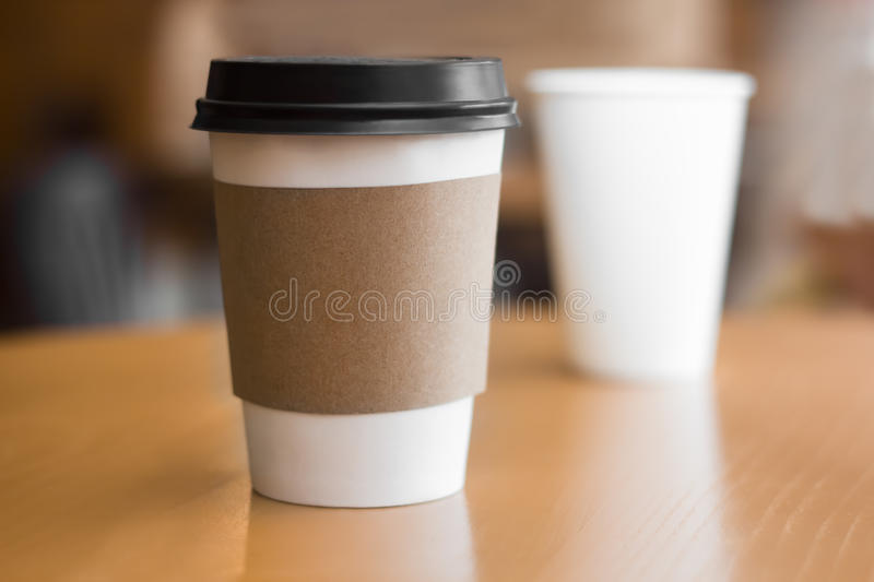 Two paper coffee cups. On wooden table stock photos