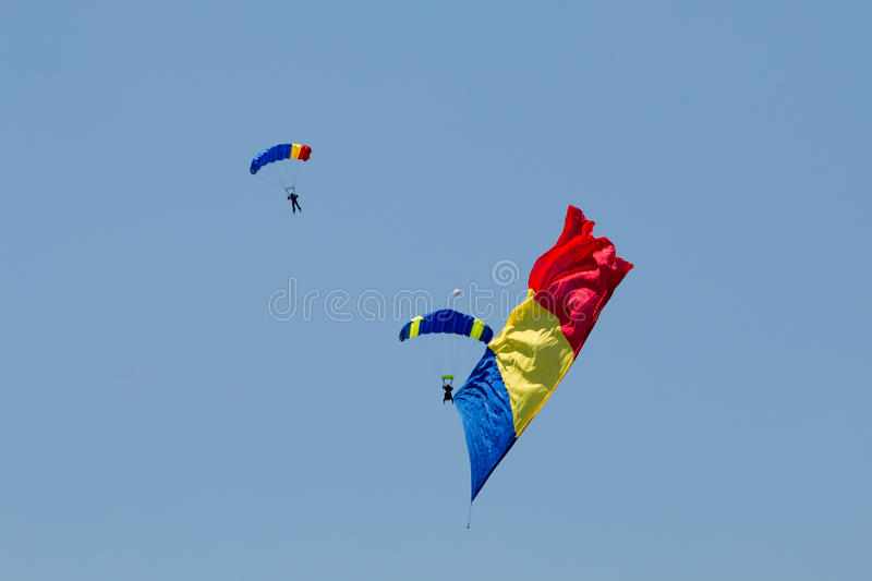 Two parachutes carrying the Romanian flag royalty free stock photography