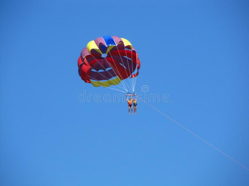Two parachutist in the sky flying under one common parachute royalty free stock photo