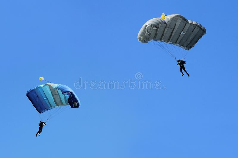 Two Parachutists fly stock images