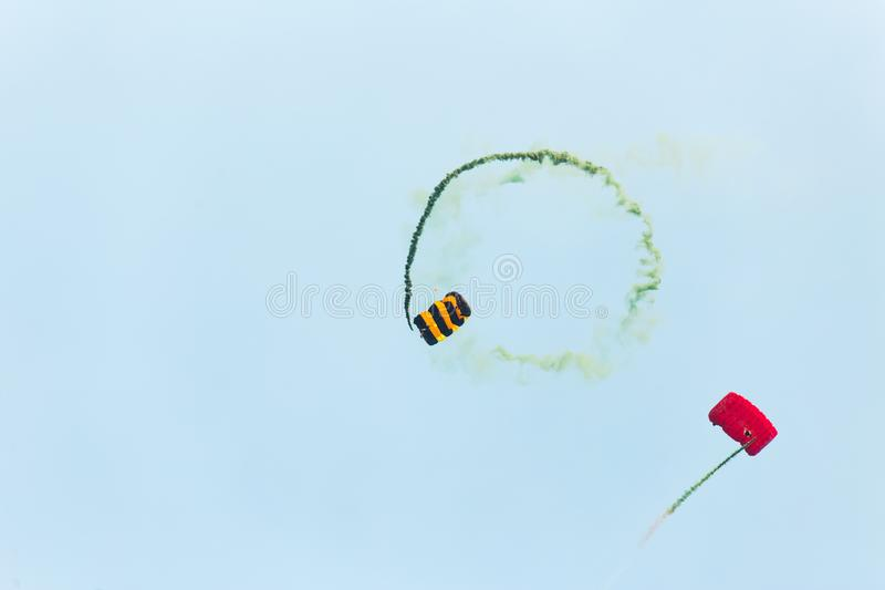Two parachutists fly to the blue sky royalty free stock image