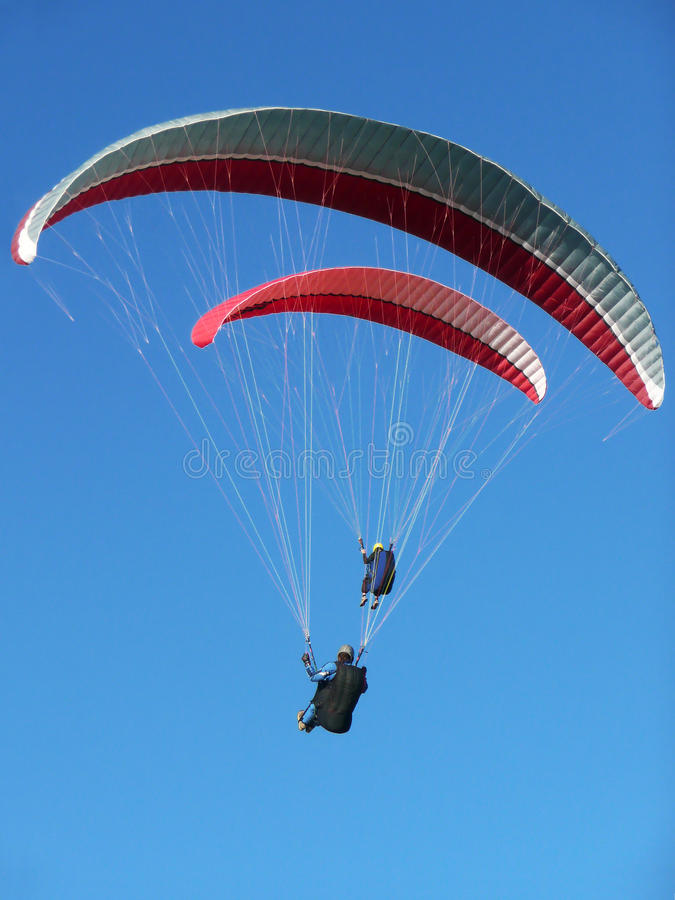 Two paragliders paragliding stock photography