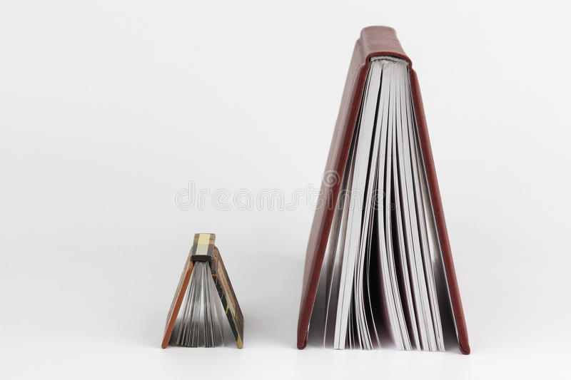 Two parted standing at the end of the book. The two parted standing at the end of the book royalty free stock images