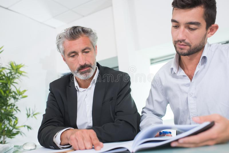 Two partners negotiating stock image