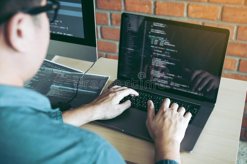 Two partnerships developing programming and coding technologies working on laptop and analyzing together stock photos