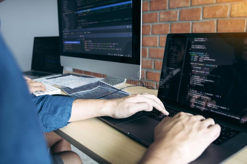 Two partnerships developing programming and coding technologies working on laptop and analyzing together royalty free stock images