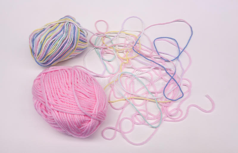 Two Pastel Pink, Periwinkle, Yellow and Mint Green Skeins of Yarn stock photo