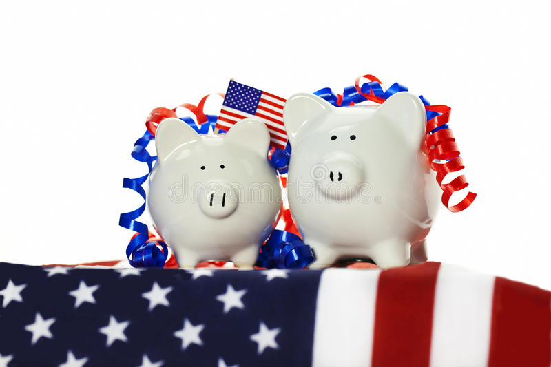 Two patriotic piggy banks royalty free stock images