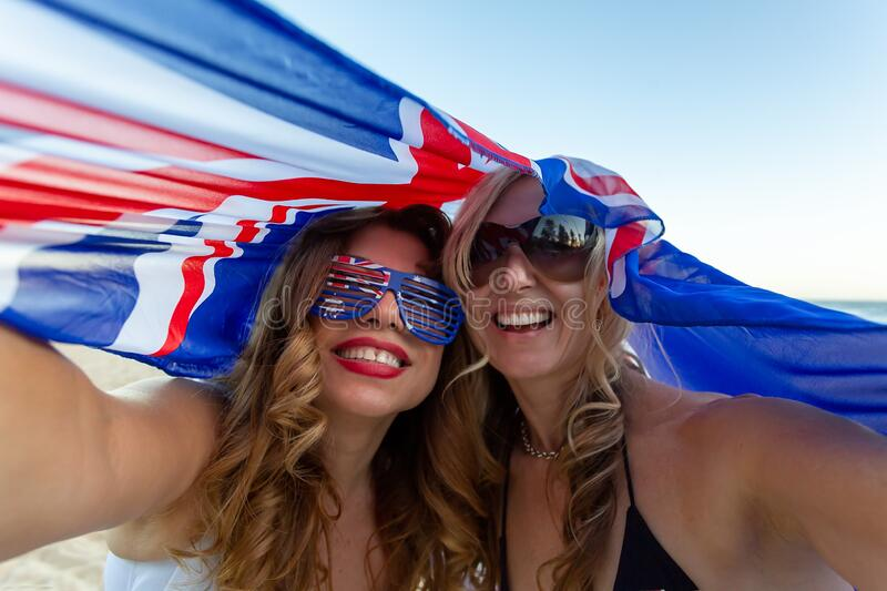 Two patriotic women celebrate Australia Day royalty free stock images