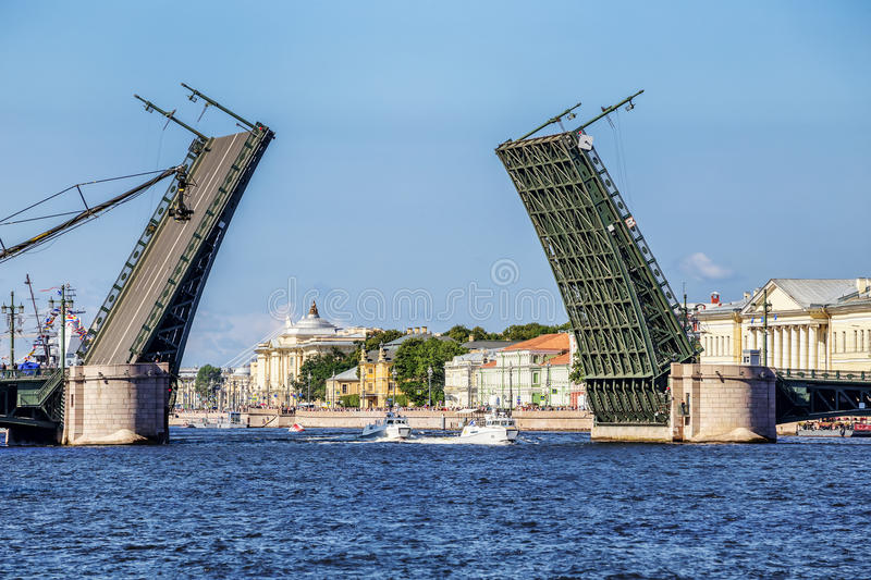 Two patrol boats of the commander-in-chief of the Navy pass under a raised Palace bridge in St. Petersburg. SAINT-PETERSBURG, RUSSIA - JULY 23, 2017: Two patrol royalty free stock image