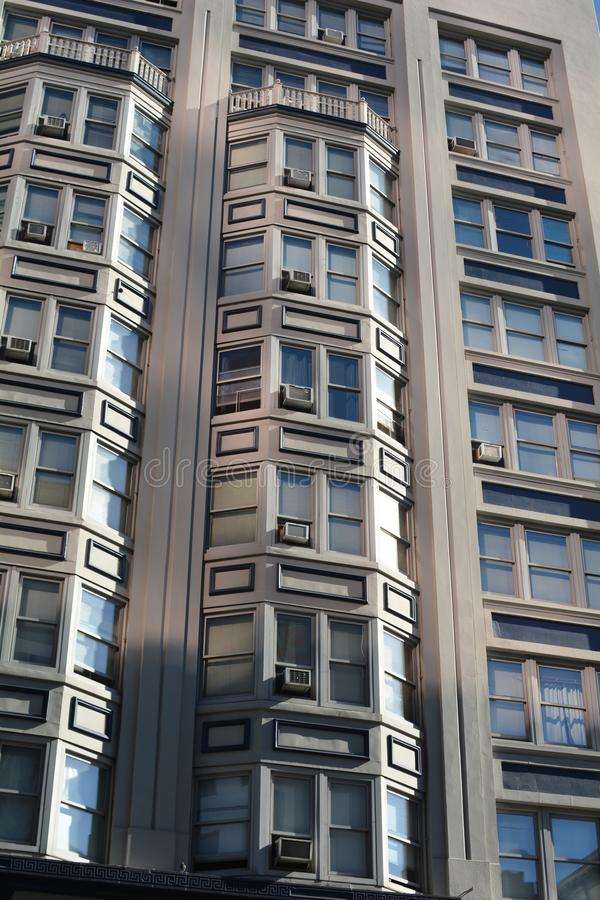 Apartment building windows in Portland, Oregon. Two patterns of windows on an apartment building in downtown Portland, Oregon create a textured abstract design royalty free stock photography
