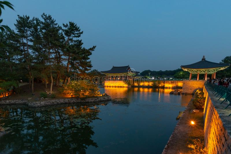 Two pavilions of the Donggung Palace reflecting into  the Wolji Pond. GYEONGJU, SOUTH KOREA - JUNE 5, 2019: Two pavilions of the Donggung Palace and the Wolji royalty free stock images