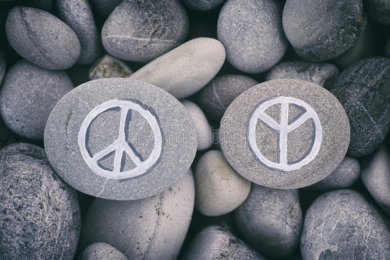 Two peace symbols on stones stock photography