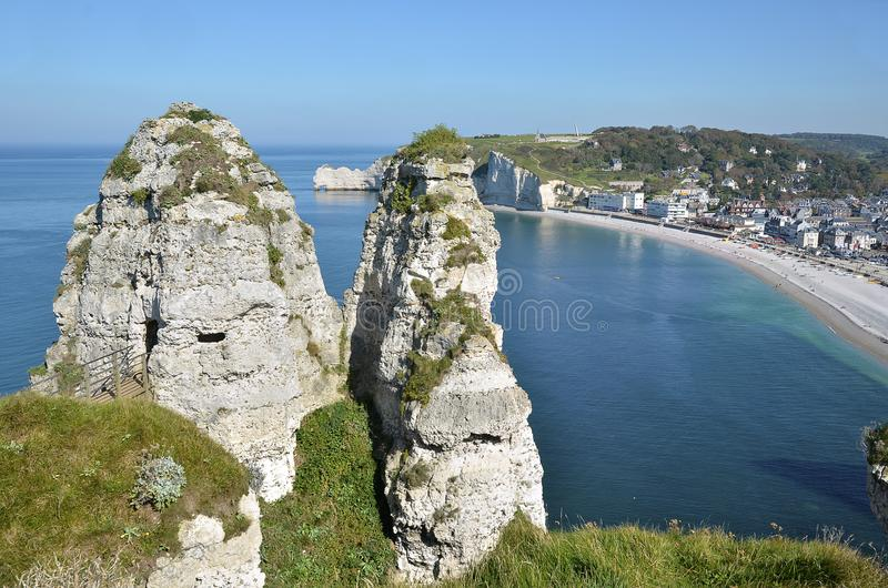 Famous cliffs of Etretat in France. The two peaks of La chambre des demoiselles on the famous cliffs of Etretat, commune in the Seine-Maritime department in the royalty free stock images