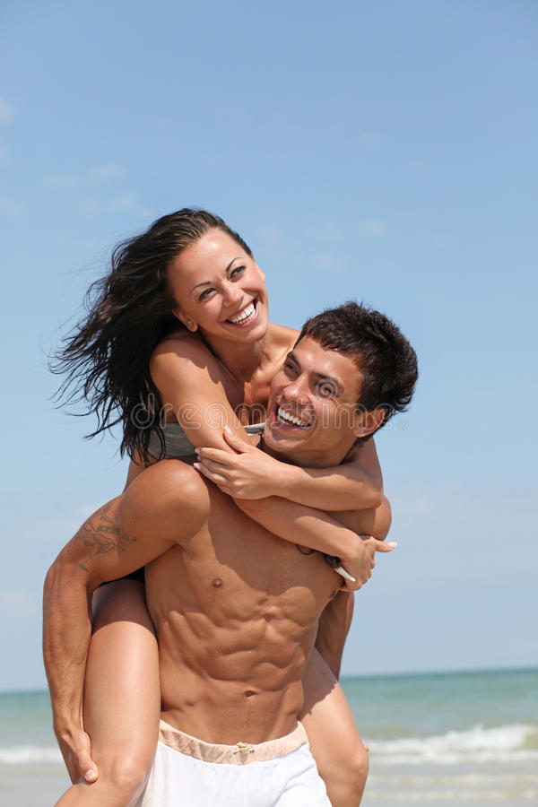 Two people. Beautiful couple posing on the sandy sea coast stock photos
