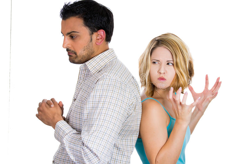 Two people back to back, angry at each other stock photo