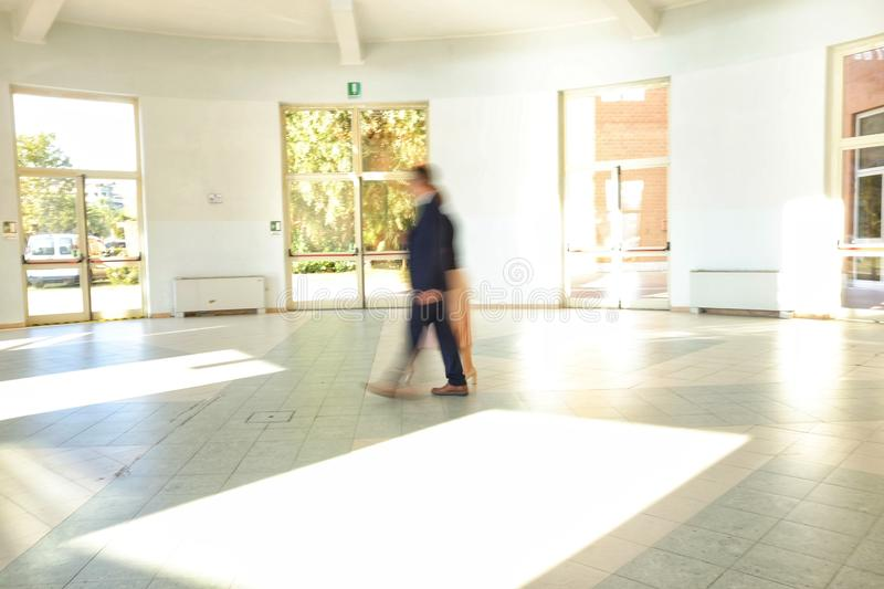Two people blurred in the corridor royalty free stock image