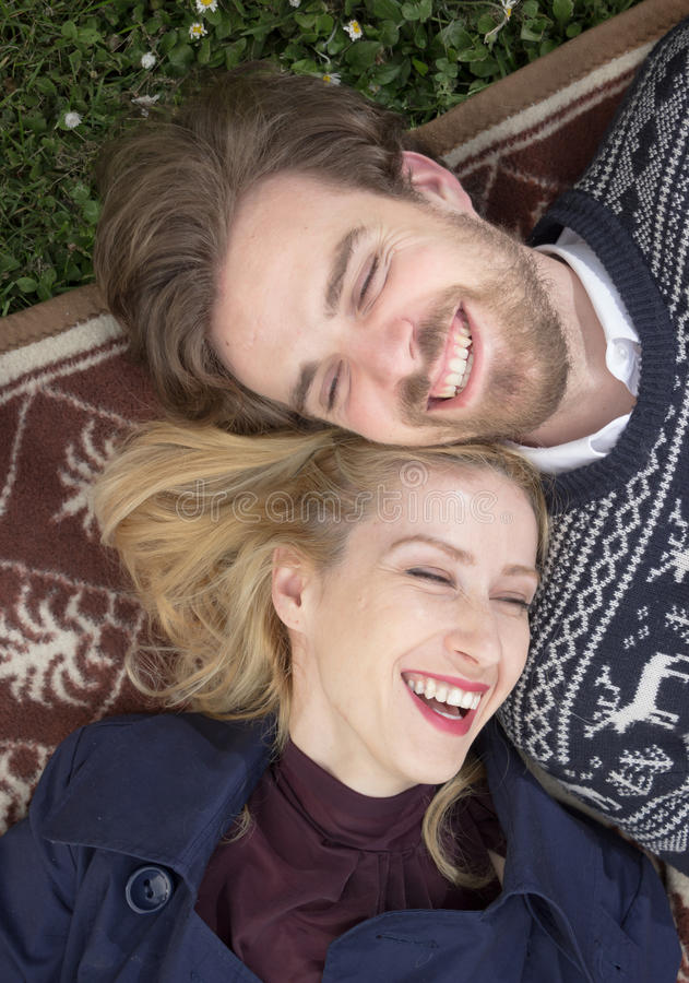 Two people boy girl laughing elevated view. royalty free stock photos