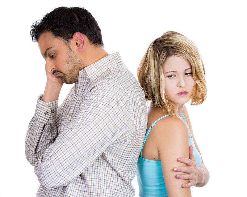 Two people, couple woman and man, back to back, very sad, disappointed with each other. Closeup portrait of two people, couple women and man, back to back, very royalty free stock image