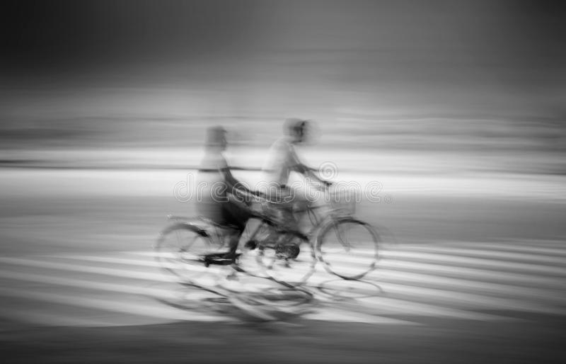Two people cycling stock photos