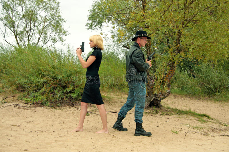 Two People With Guns, Duel Stock Image