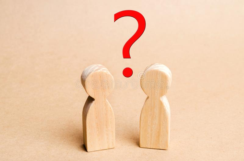 Two people are looking for an answer to a question, consultation. Discussion, discussion. family psychotherapy, question between people royalty free stock photos