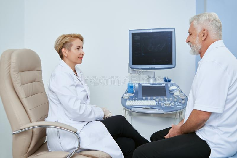 Two people on medical observation in hospital. stock photos