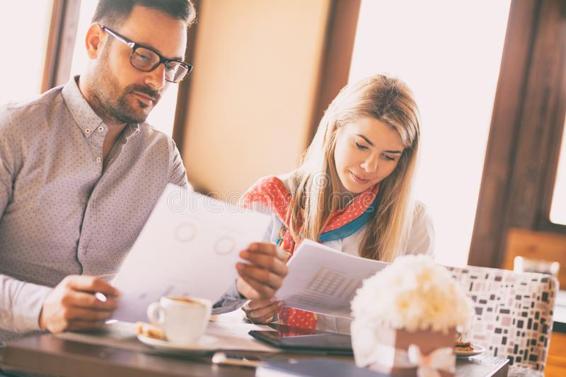 Business people meeting and discuss in coffee shop stock photo