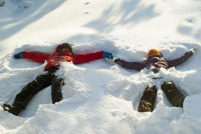 Snow angels in a deep snowdrift stock photography