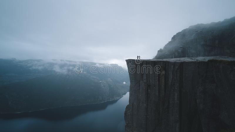 Two People On Mountain Cliff Free Public Domain Cc0 Image