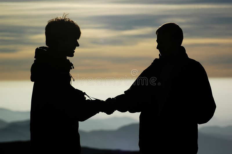 Two people at Omu shelter. Bucegi - Romania royalty free stock images
